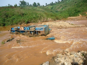 Korean Dave's Gold processing machine lying on its side in The Nizi River