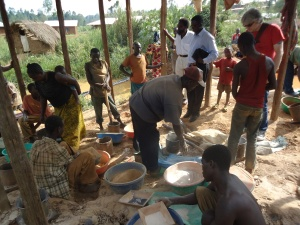 Crushing and mercury processing of gold in a small roadside hut.