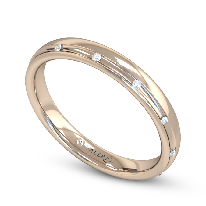 This beautiful Fairtrade Rose Gold wedding band is channel set with twelve dainty diamonds.