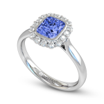 Cushion cut sapphire surrounded by round brilliant cut diamonds, set in 18ct. Fairtrade white gold.
